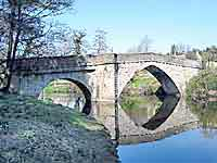 bridge over the river derwent in derbyshire at froggatt